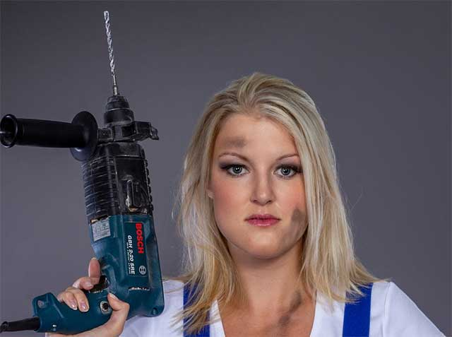 Diy Woman Holding a Corded Power drill